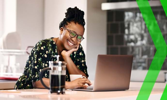 Woman smiling looking at laptop