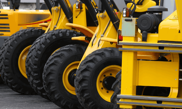Yellow machinery lined up at hiring centre