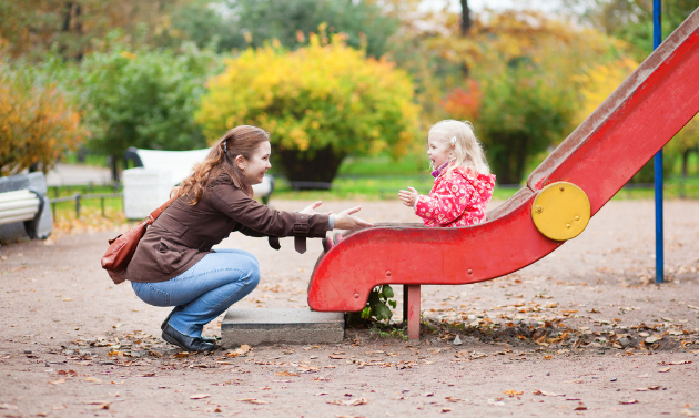 Woman and child playing at playground