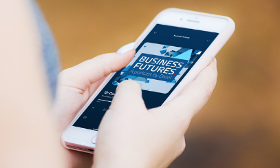 Woman holding a phone playing episode 12 of the Business Futures podcast
